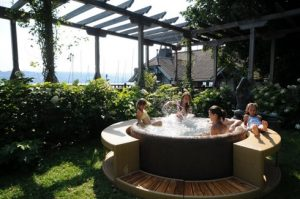 Children enjoying family time in hot tub
