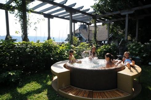 Children enjoying family time in hot tub