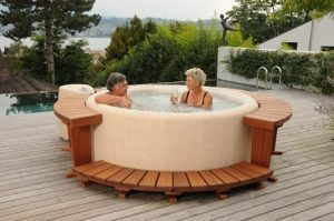 couple enjoying drinks in the hot tub