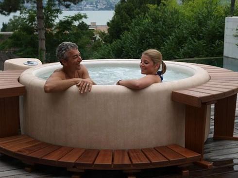 couple unwinding in hot tub