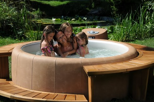 family relaxing in hot tub