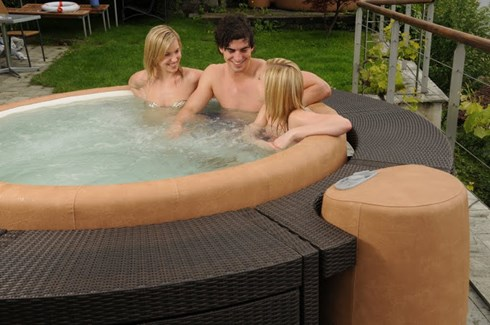 friends relaxing and talking in hot tub