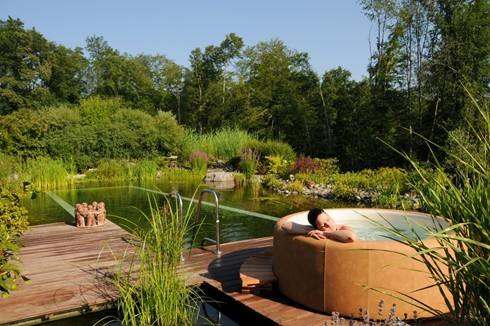 person relaxing in hot tub